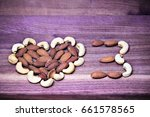Small photo of Omega 3: enlarged heart. A heart and a 3 formed by cashews and almonds on purple wood. Cashews contain Omega 3 fatty acids. Almonds contain Omega 6. Both are ALAs, medically used against disease.