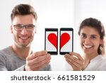 smiling young couple showing... | Shutterstock . vector #661581529