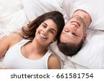 elevated view of smiling young... | Shutterstock . vector #661581754