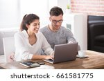smiling young couple looking at ... | Shutterstock . vector #661581775