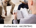 close up of a woman reading... | Shutterstock . vector #661587841