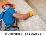 worker moving plywood boards... | Shutterstock . vector #661602691