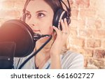 Caucasian Girl in Her 20s in the Audio Recording Studio. Recording Voice.  - stock photo