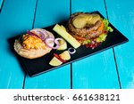 beef burger and vegetables on a ... | Shutterstock . vector #661638121