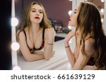 young beautiful woman applying... | Shutterstock . vector #661639129
