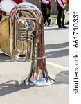 Small photo of music instruments closeup. bright big bass tuba on pavement background during the break of orchestra performance.