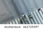 Stock photo the busy city crowd move to pedestrian crosswalk on business traffic road aerial photo top view 661725397