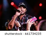 Small photo of NASHVILLE, TN - JUNE 08: Luke Bryan performs at Nissan Stadium during the 2017 CMA Festival on June 8, 2017 in Nashville, Tennessee.