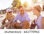 group of friends with guitar... | Shutterstock . vector #661770961