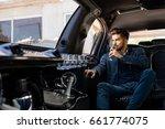 young businessman enjoying... | Shutterstock . vector #661774075