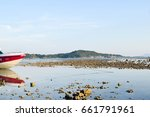boat in the water in front of... | Shutterstock . vector #661791961