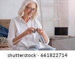 Cheerful Elderly Woman Holding...