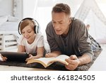 enthusiastic father and... | Shutterstock . vector #661824505