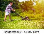 handsone young man is mowing... | Shutterstock . vector #661871395