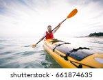 kayaking. man paddling a kayak. ... | Shutterstock . vector #661874635