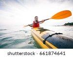 man paddling sea kayak.... | Shutterstock . vector #661874641