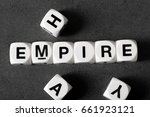 word empire on white toy cubes | Shutterstock . vector #661923121