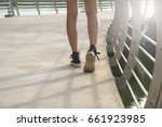 a young woman is walking... | Shutterstock . vector #661923985