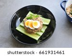 kao pad kra prao or thai rice... | Shutterstock . vector #661931461