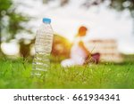 water bottle on green grass and ... | Shutterstock . vector #661934341