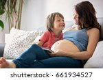 young pregnant woman  reading a ... | Shutterstock . vector #661934527