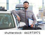car dealer in showroom  | Shutterstock . vector #661973971