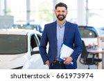 car dealer in showroom  | Shutterstock . vector #661973974