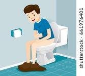 man sitting on toilet ... | Shutterstock .eps vector #661976401
