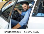 happy young man with new car | Shutterstock . vector #661977637