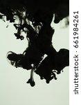 black ink drops in water  | Shutterstock . vector #661984261