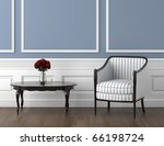 interior design of classic room in blue and white with chair and a vase of roses on the table - stock photo