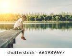 kid boy look down the water on... | Shutterstock . vector #661989697