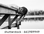 kid boy look down the water on... | Shutterstock . vector #661989949