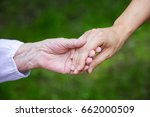 hands of young adult and senior ... | Shutterstock . vector #662000509