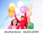 happy kids with balloons | Shutterstock . vector #662012044