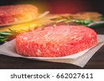 raw burgers on parchment paper... | Shutterstock . vector #662027611
