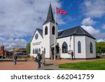 Small photo of Cardiff Bay, Cardiff, Wales - May 20, 2017: Norwegian Church and arts centre, with flag and people