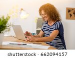 middle age woman at the office... | Shutterstock . vector #662094157