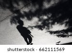blurry shadow of a boy  pigeon... | Shutterstock . vector #662111569