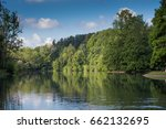 great forest lake and woods.... | Shutterstock . vector #662132695
