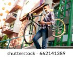 casual businessman carrying the ... | Shutterstock . vector #662141389