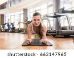 front view of a young fit woman ...   Shutterstock . vector #662147965