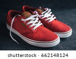 pair of stylish red sneakers on ... | Shutterstock . vector #662148124