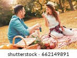 picnic time. young couple... | Shutterstock . vector #662149891