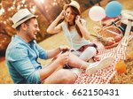 picnic time. young couple... | Shutterstock . vector #662150431