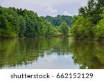 Lake With Deciduous Forest...