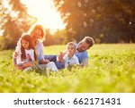 children in green nature make... | Shutterstock . vector #662171431