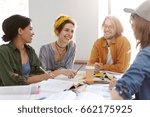 four friendly mixed race... | Shutterstock . vector #662175925