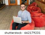 happy man working on laptop.... | Shutterstock . vector #662179231