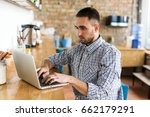 serious man working on laptop.... | Shutterstock . vector #662179291